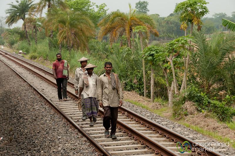 Bangladeshi Men Walking Along Railroad Tracks - Rural Bangladesh
