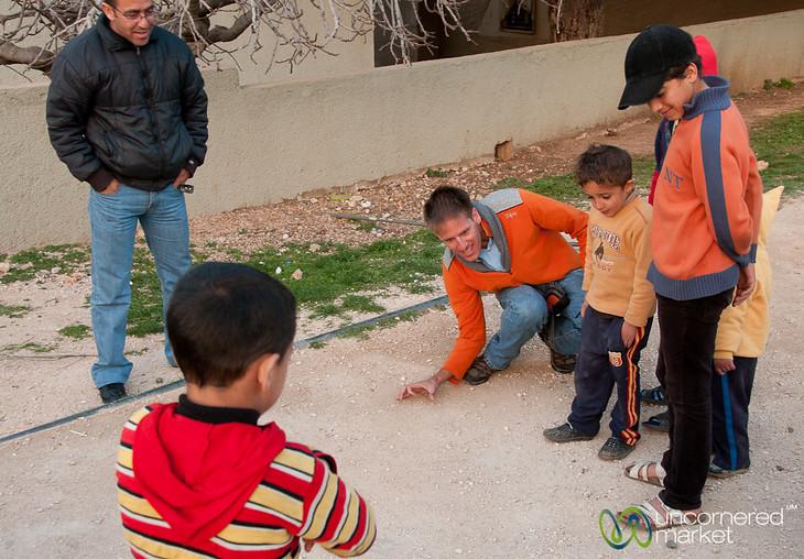Dan Plays Marbles with the Kids of Rasoun (Jordan)