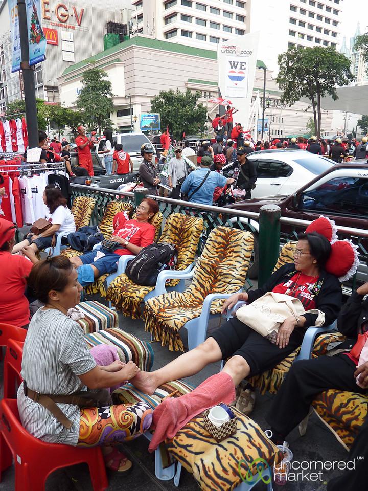 A Little Foot Massage During a Red Shirts Rally - Bangkok, Thailand