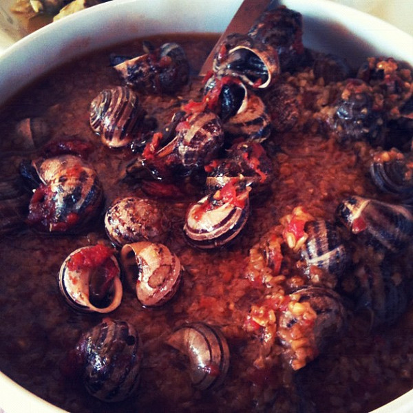 Village Cretan lunch of snails with tomatoes & cut wheat. Delicious.