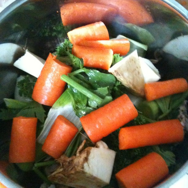 Making homemade chicken stock.