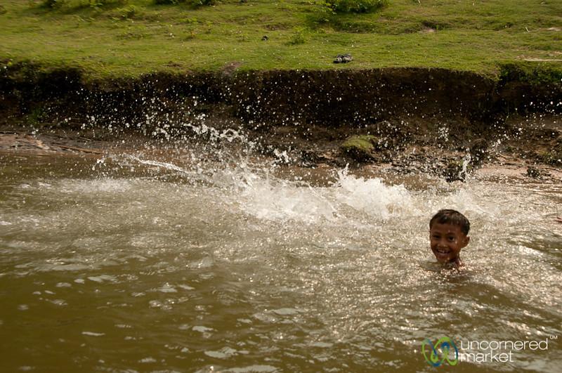 Boy Swimming in Shangu River - Bandarban, Bangladesh