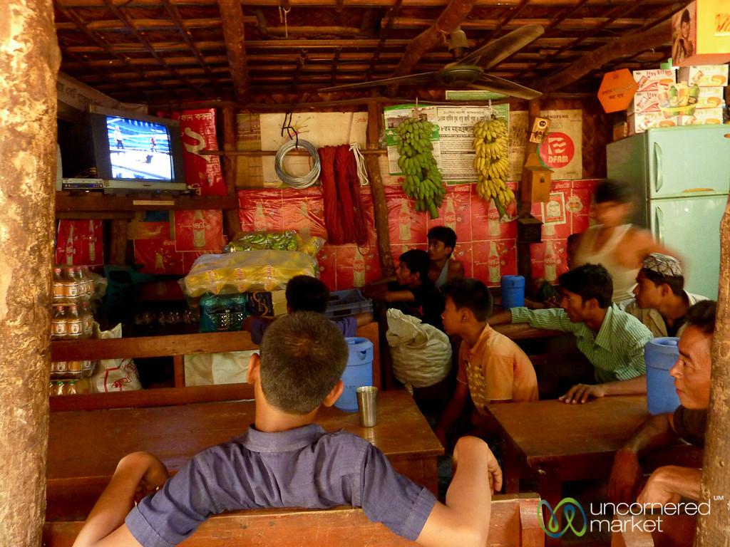 Bangladeshi Boys Watching Wrestling at Tea House - Bangladesh