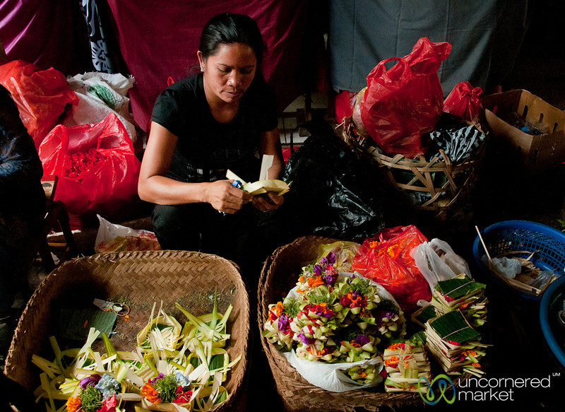 Woman Making Offerings at the Market - Bali, Indonesia