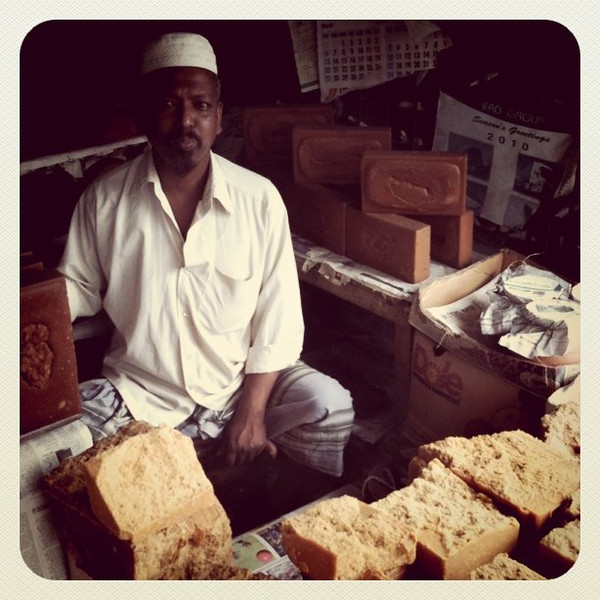 Sugar tasting on streets of Rajshahi - reminds us of molasses #Bangladesh