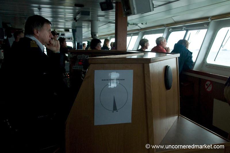 Captain Concentrates on Lemaire Channel - Antarctica