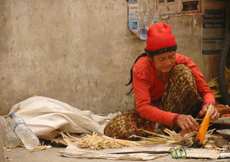 Husking Dried Corn - Patan, Nepal