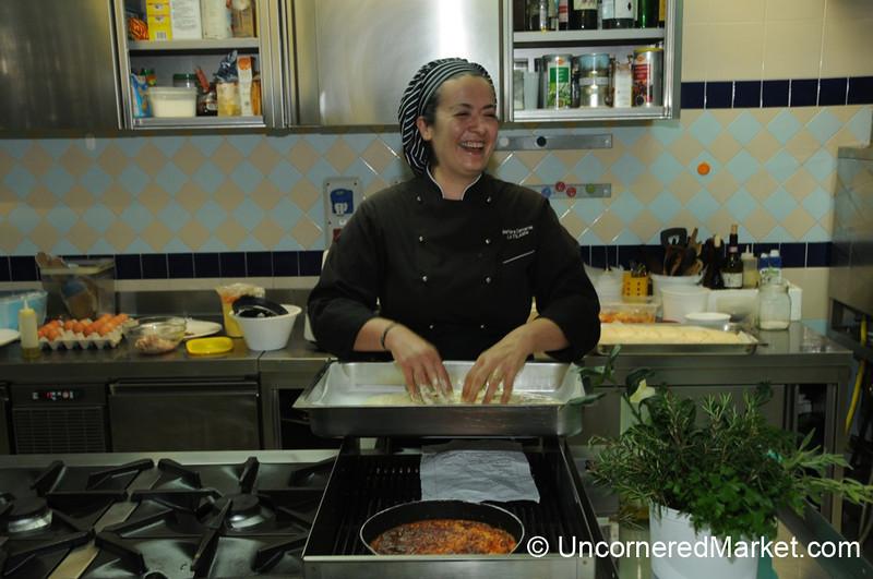 Spreading Out the Foccacia Dough - La Filanda Restaurant, Manciano