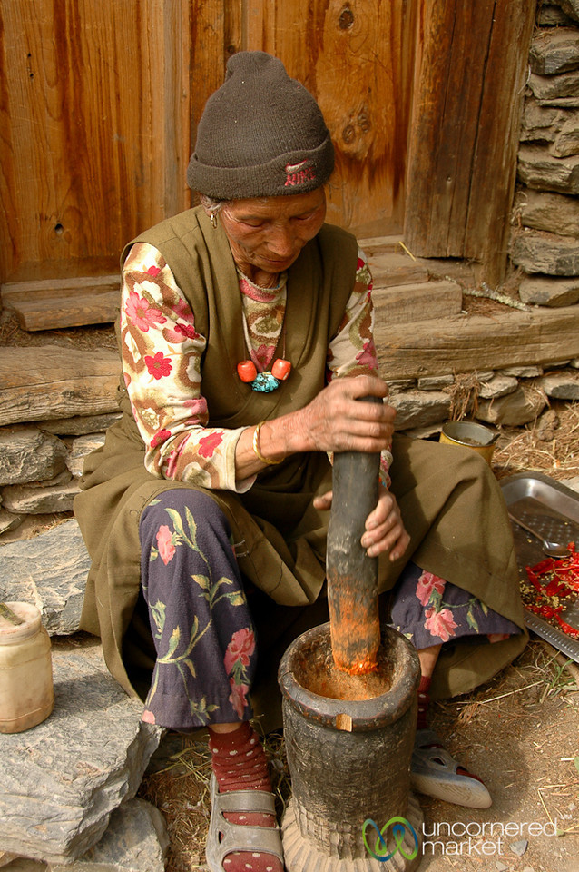 Grinding Up Chili Peppers - Annapurna Circuit, Nepal