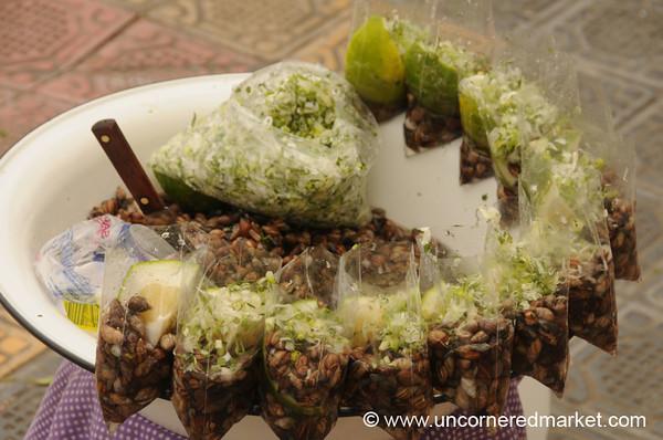 Snack of Tiny Snails - Otavalo Market, Ecuador