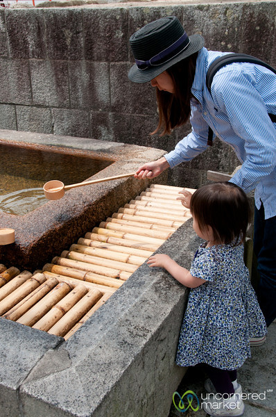 Cleansing with Water at Itsukushima Shinto Shrine - Miyajima, Japan