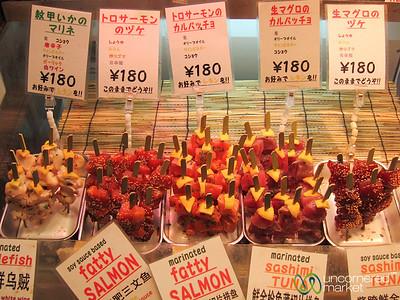 Sashimi on a Stick at Nishiki Market - Kyoto, Japan