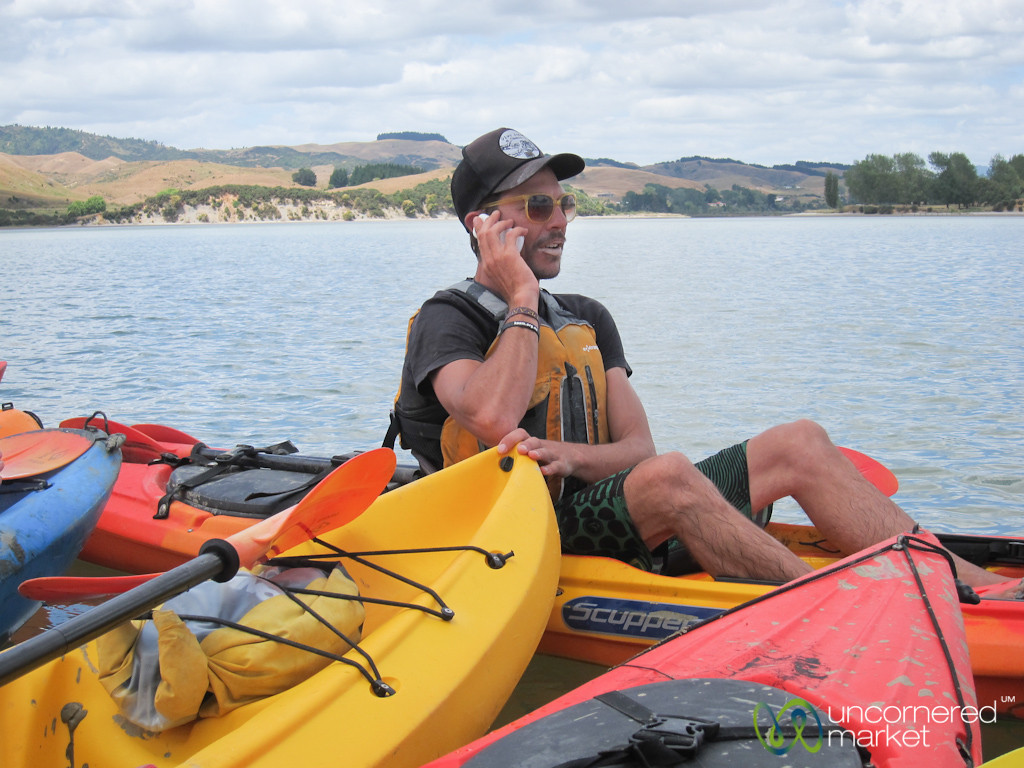 Talking on Mobile Phone in Middle of Water - Raglan, New Zealand
