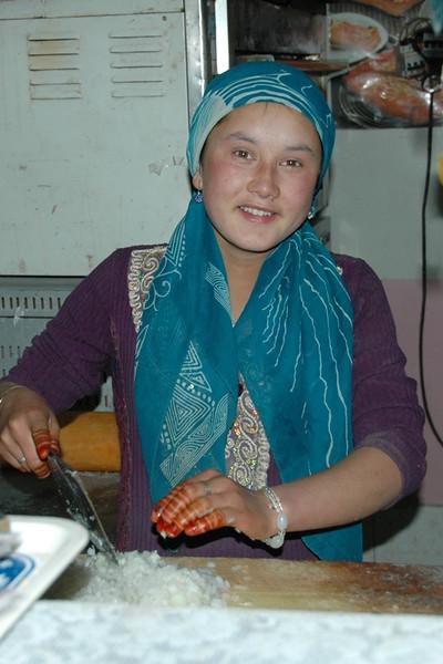 Uighur Woman Chopping Onions - Kashgar, China