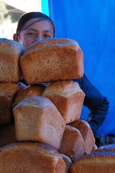 Tajik Woman Hiding Behind Bread - Dushanbe, Tajikistan