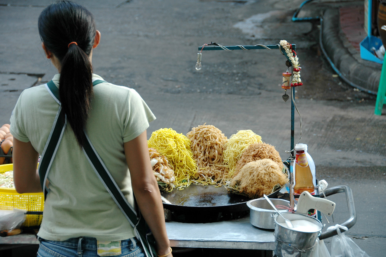 Woman Selling Pad Thai on the Street - Bangkok, Thailand