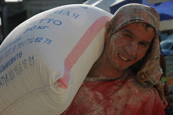 Man Carrying a Sack of Flour - Shakhrisabz, Uzbekistan
