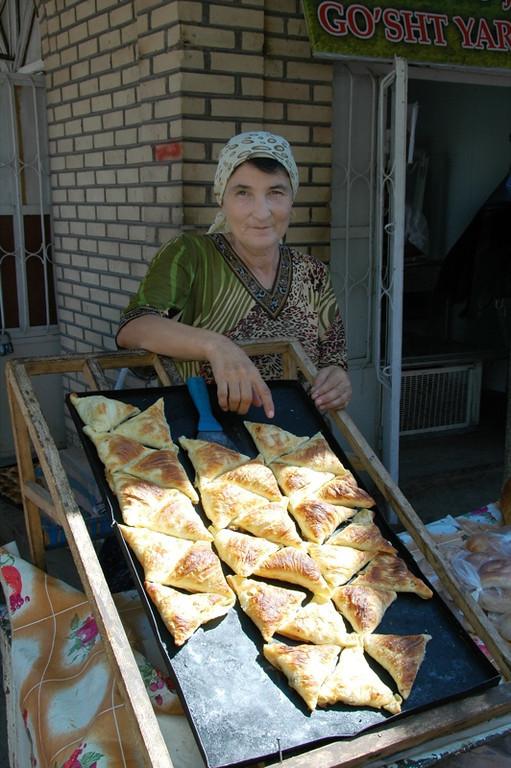 Woman Selling Fresh Somsas - Khiva, Uzbekistan