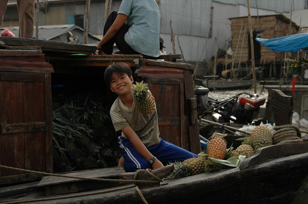 Boy Selling Pineapples - Mekong Delta, Vietnam