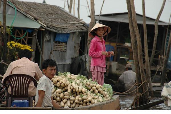 Selling Turnips at Floating Market - Mekong Delta, Vietnam