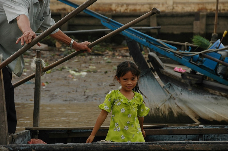 Girl at Cai Rang Floating Market - Mekong Delta, Vietnam