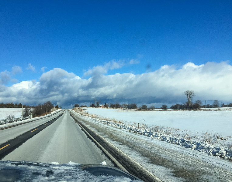 As we approach Lake Simcoe 90 Km from Toronto, we could see huge white puffy cloud banks  ahead. 20 minutes later we were in the thick of snowy road conditions.