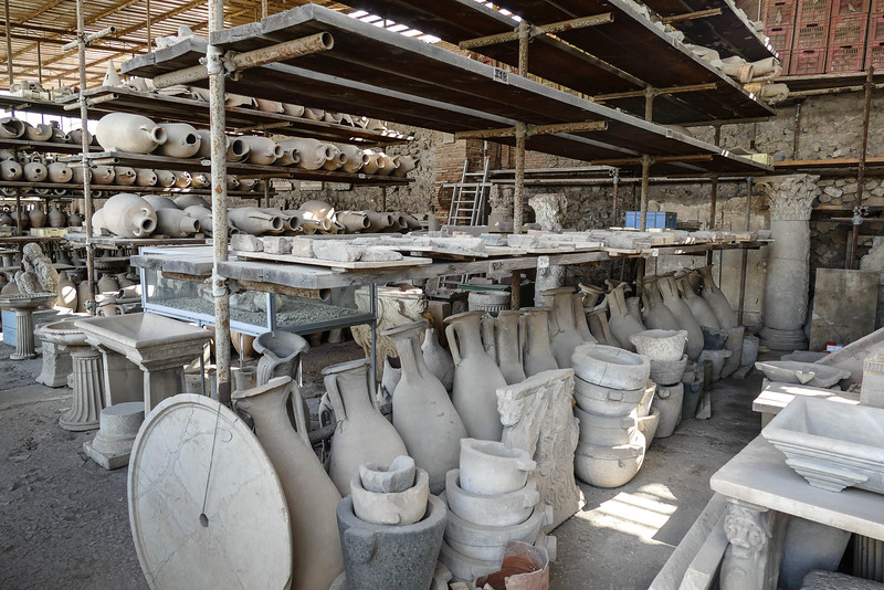 Reclaimed artifacts in storage sheds. Much work lies ahead in expanding the viewable complex.
