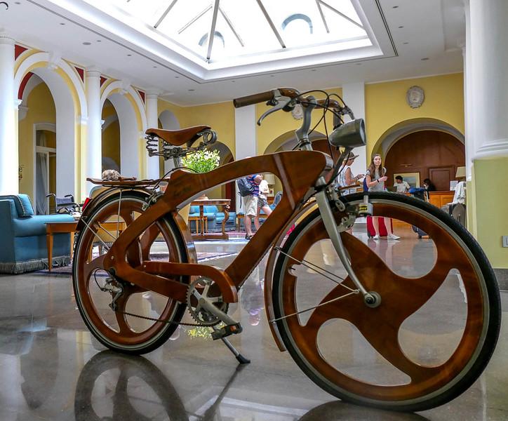 Wood frame bicycle on display.
