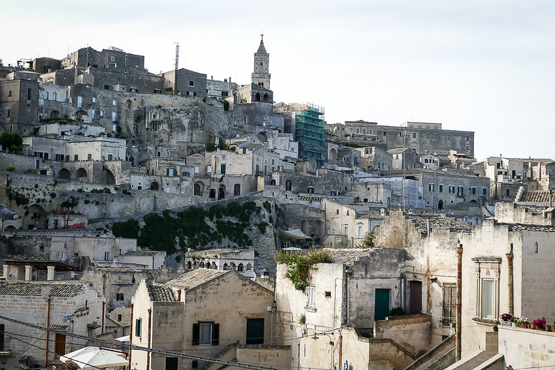 Matera - in central Italy, about a 5-6 hour direct drive from Amalfi. The home facades have many rooms built into stone caves behind.