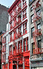 Fire escapes out front are quite typical, and often brightly painted.
