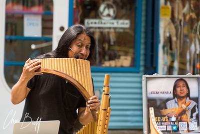 Edgar Muenala plays his flute