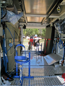 Loading Steph's bike. Lago Gutierrez, Argentina.