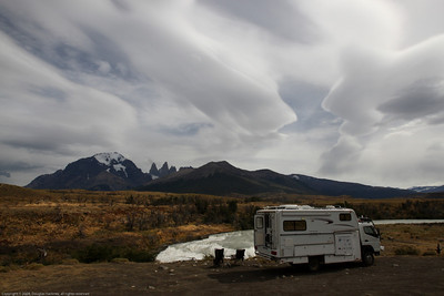 Waterfall campsite clouds. Torres del Paine National Park, Chile.