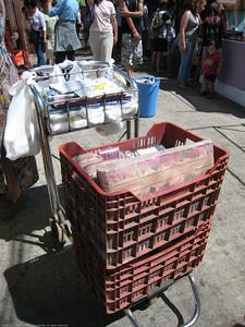 vendor providing bags/sacks to market stall vendors, market, El Bolson, Argentina.