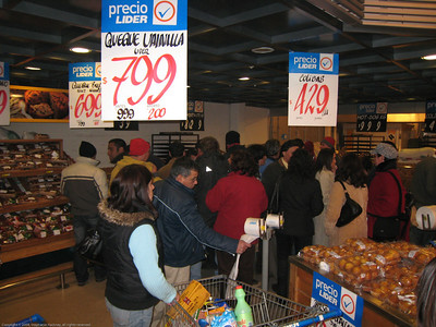 At the supermarket waiting for the bread to come out. Bread is very serious business in this part of the world. When the bread comes out and hits the bins it is a free for all at an NHL level of intensity. Linares, Chile.