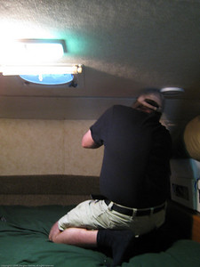 Removing the trim panel above the berth to investigate why we were seeing and feeling moisture in the ceiling. Valdivia, Chile.