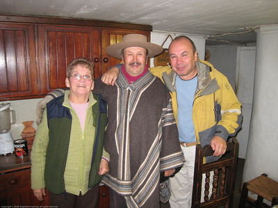Jorge with his parents at their farm. His father is wearing typical rancher/farmer attire. Near Linares, Chile.