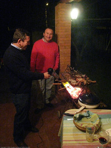 Marcos using a hair dryer to get the charcoal going. Linares, Chile.
