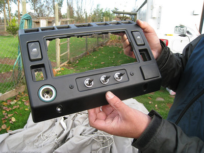 Jorge working on installing some vintage Land Rover switches in his current generation Lnad Rover Defender.