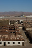 Abandoned ghost town of Humberstone, Chile. Site of a former nitrate oficina (processing plant). Functioning modern plant in the background.