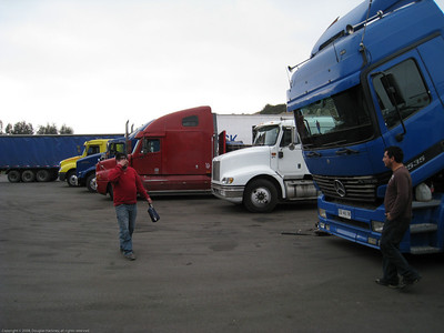 Typical lineup of Chilean trucks. Copec station just north of La Serena, Chile.