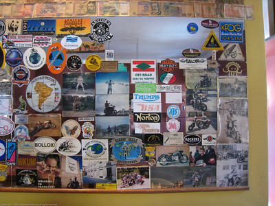 Mirror with stickers. Norton's Rat bar. Cusco, Peru.