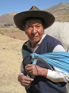 Local man with sickle and bundle. Along the road in Peru.