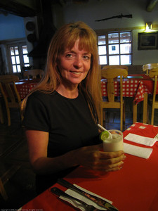 Happy girl with Pisco sour. Along the road in Peru.