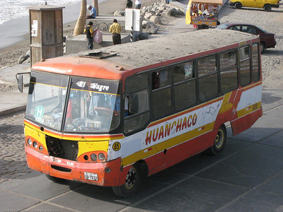 Local bus that runs into the city and back. Some of these are pretty ratty. Huanchaco, Peru.