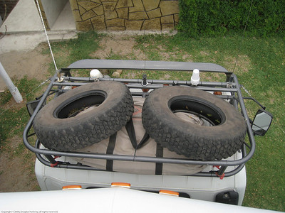 We stowed the two best remaining Yokohama tires on the cab with the intention of carrying them as further spares. Huanchaco, Peru.