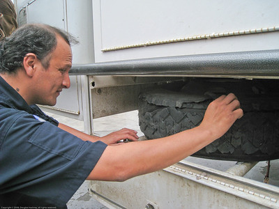 Sales rep inspecting blowout. Installing new tires for the Fuso. Trujillo, Peru.