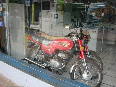 Motorcycles for sale at the appliance store, which is very common in this part of Latin America. Otavalo, Ecuador.