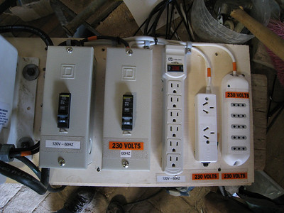 I set up output breakers and outlet strips for each voltage: 120 and 220 VAC. Ecuador is a 120 VAC country. Everything south of there in South America is 220 VAC, as is most of the rest of the world. We had  the 220 VAC outlet strips from our time in 220 VAC countries. I made the 120V labels with our label maker. I had the 230V stickers from when we built the Fuso. Rincon del Viajero. Otavalo, Ecuador.