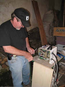Wiring up our 120/240 VAC isolation trasnformer for use at the campground. We donated it to the owners so that people from 220 VAC countries, such as Europeans, would have a source of power while at the campground. We had made essentially zero use of it in 14 months and wanted to jettison the 70 pounds / 32 kilos. Rincon del Viajero. Otavalo, Ecuador.